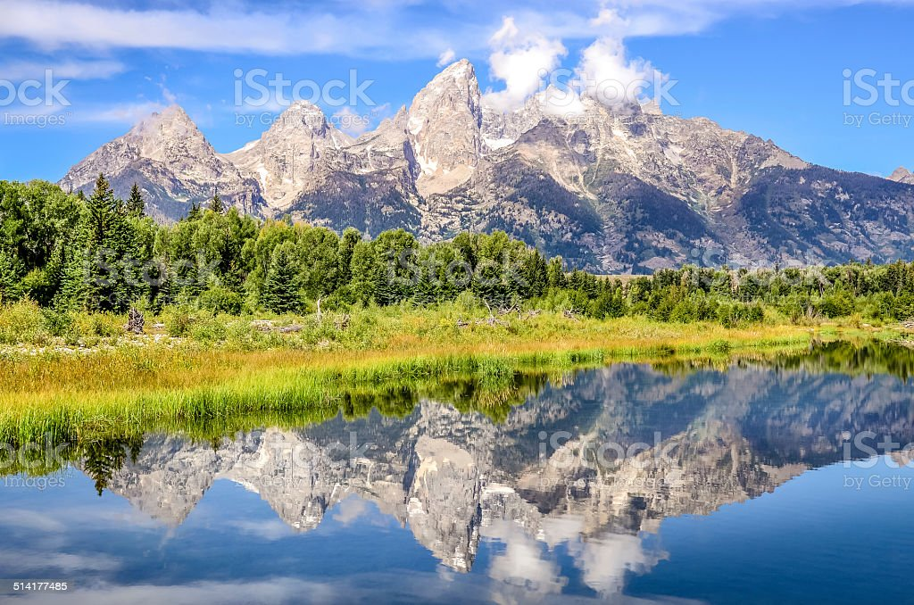 Grand Teton mountains landscape view with water reflection, USA stock photo
