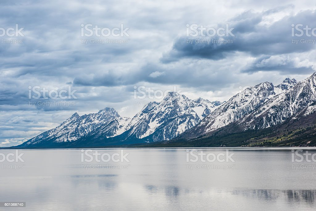 Grand Teton mountains with lake stock photo