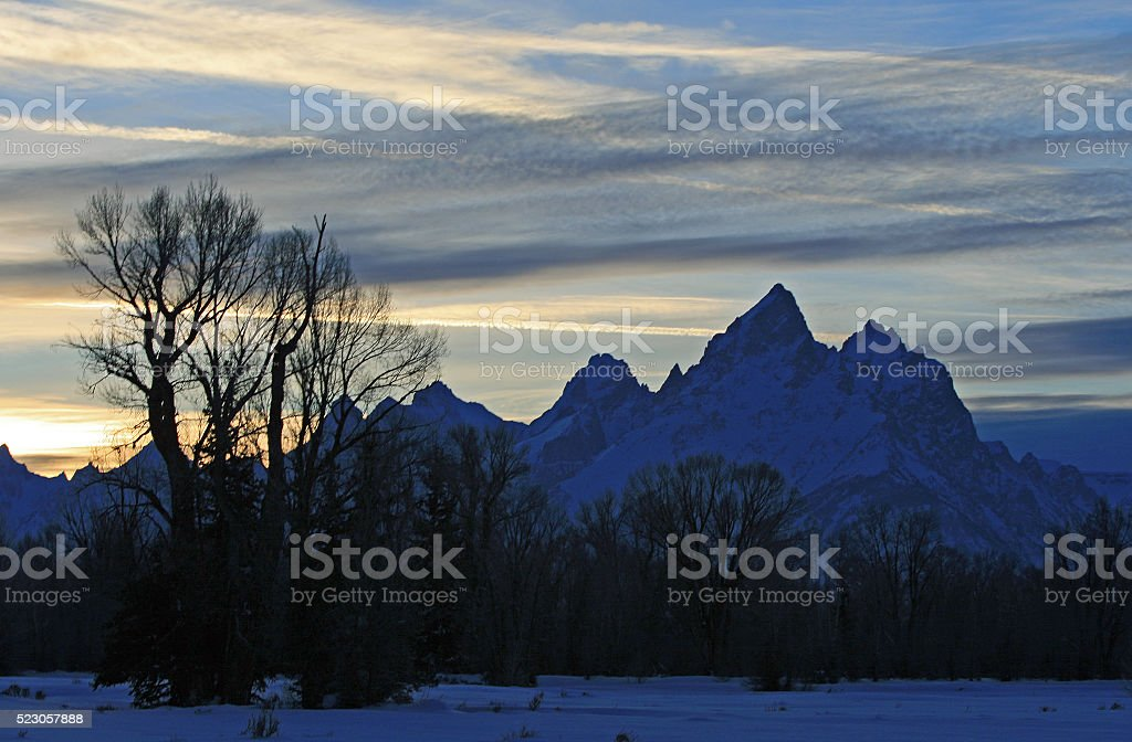 Grand Tetons at cirrus cloudscape Sunset stock photo