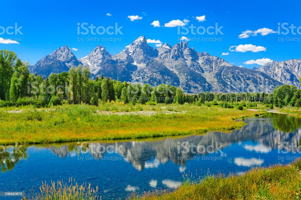 Grand Tetons mountains summer and blue sky reflected in water royalty-free stock photo