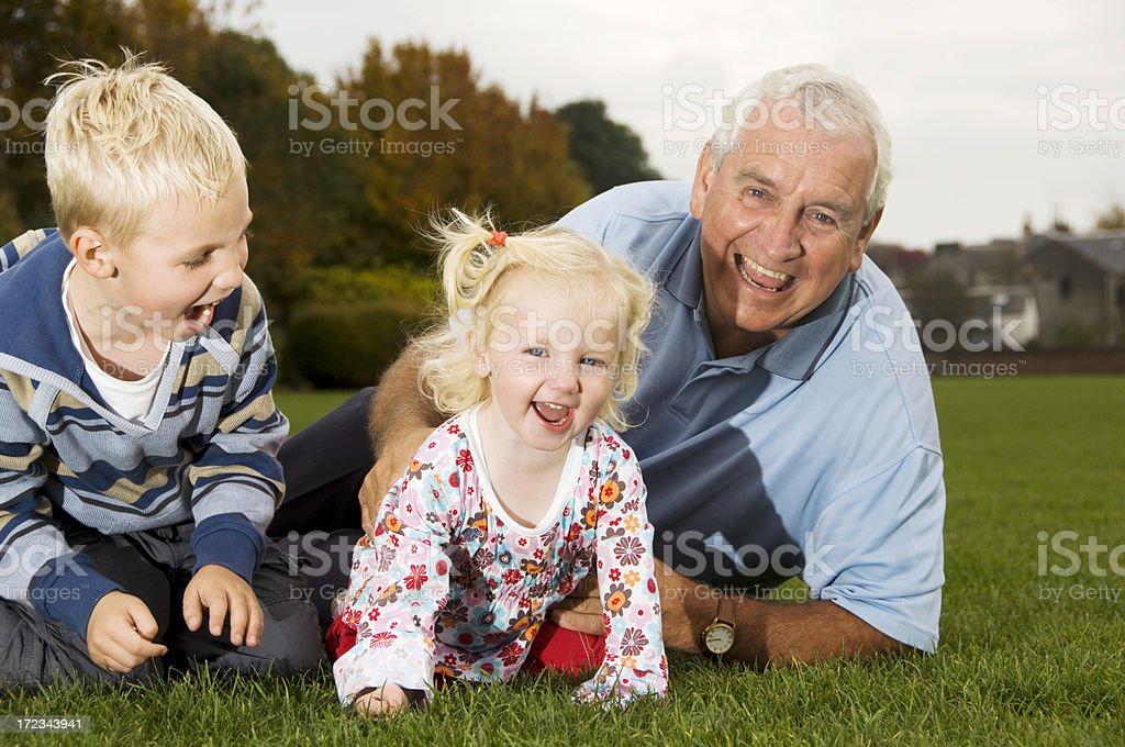 grandad and grandchildren royalty-free stock photo