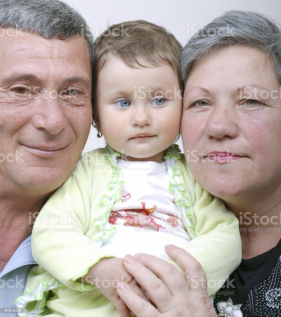 Grandad Grandma and granddaughter royalty-free stock photo