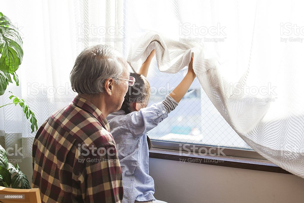 Grandchild and grandfather stock photo