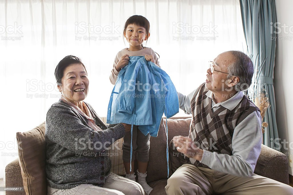 grandchild and grandparents stock photo
