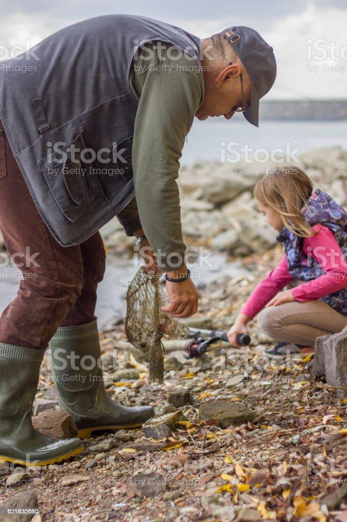 Grandchildren go fishing with Grandpa. stock photo