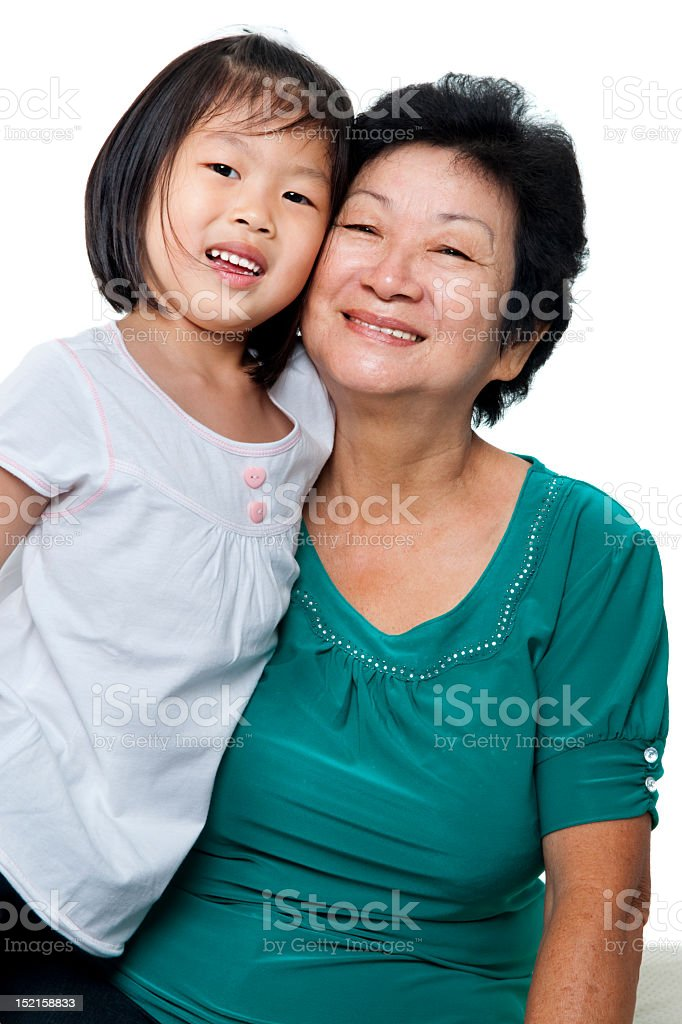 Granddaughter and grandmother smiling royalty-free stock photo