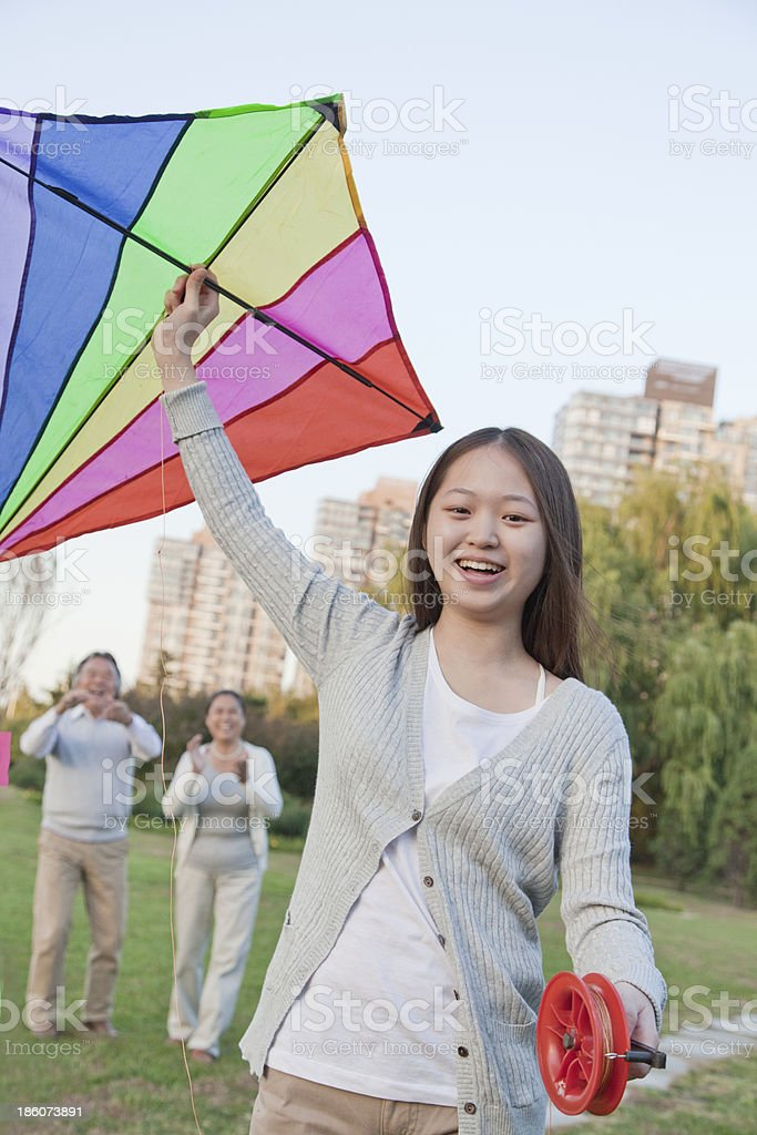 Granddaughter and grandparents with kite in the park royalty-free stock photo