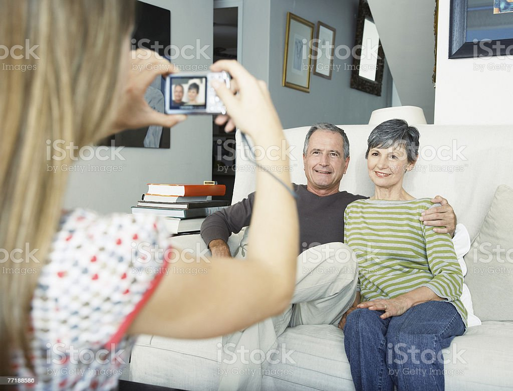 A granddaughter taking a picture of her grandparents royalty-free stock photo