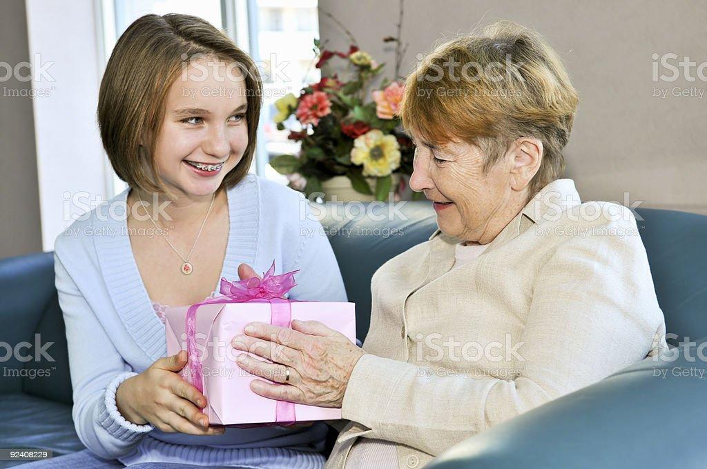 Granddaughter visiting grandmother stock photo
