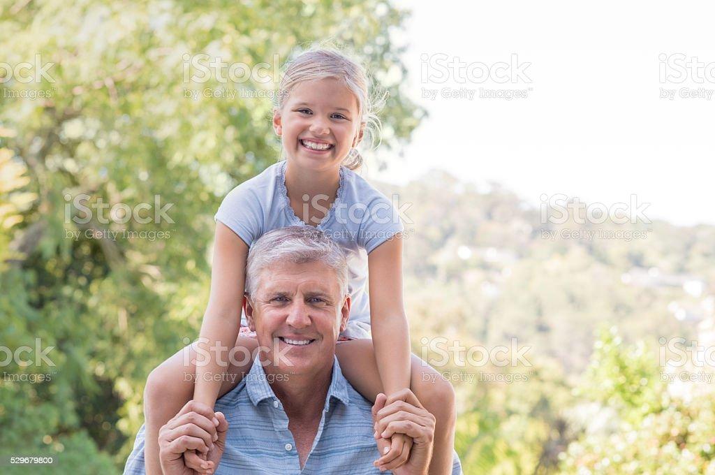 Granddaughter with grandpa stock photo