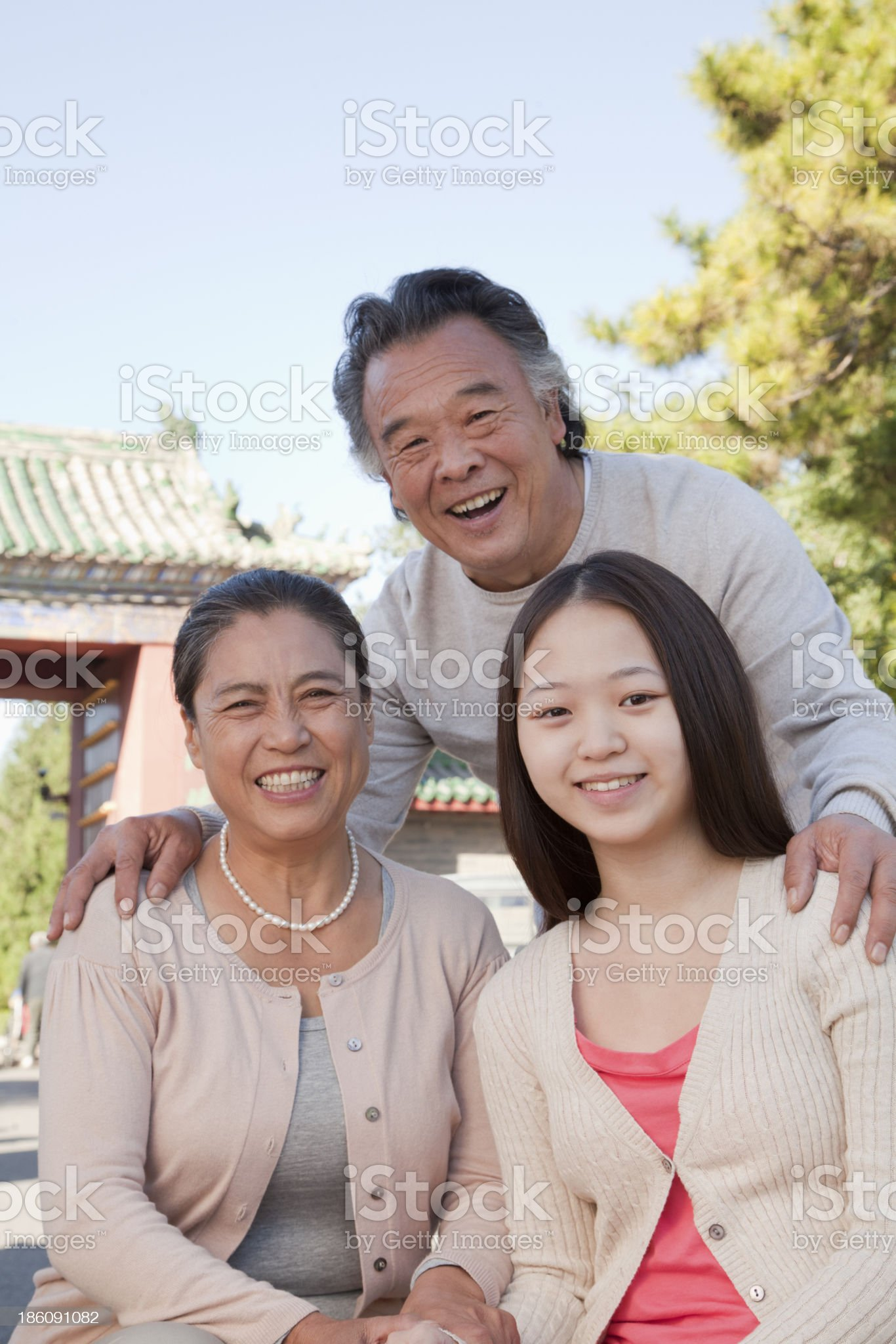Granddaughter with grandparents, portrait royalty-free stock photo