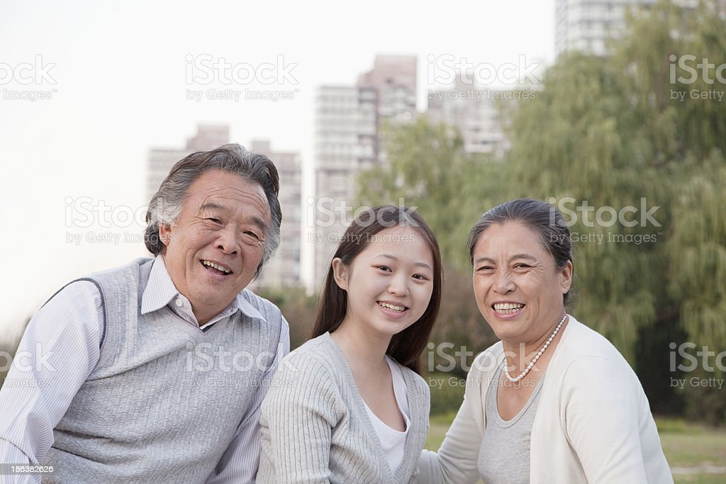Granddaughter with grandparents, portrait stock photo