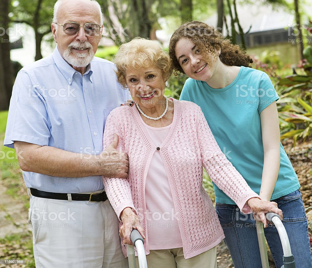 A granddaughter with her elderly grandparents stock photo