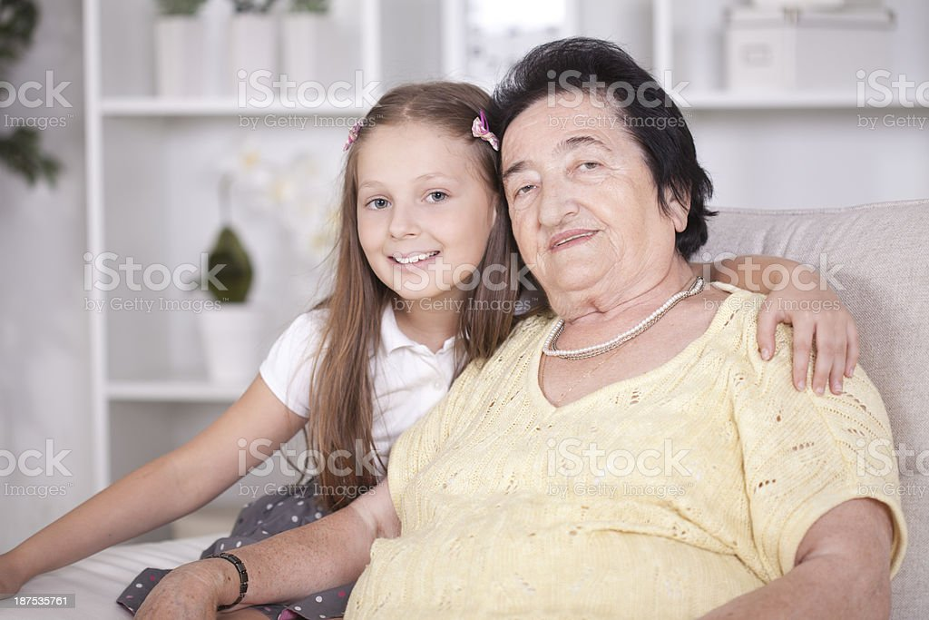 Granddaughter with her grandmother royalty-free stock photo