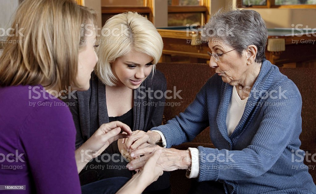 Granddaughters Observing Their Grandmother Hands royalty-free stock photo