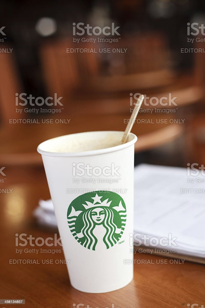 Grande Starbucks hand crafted beverage with stir stick royalty-free stock photo