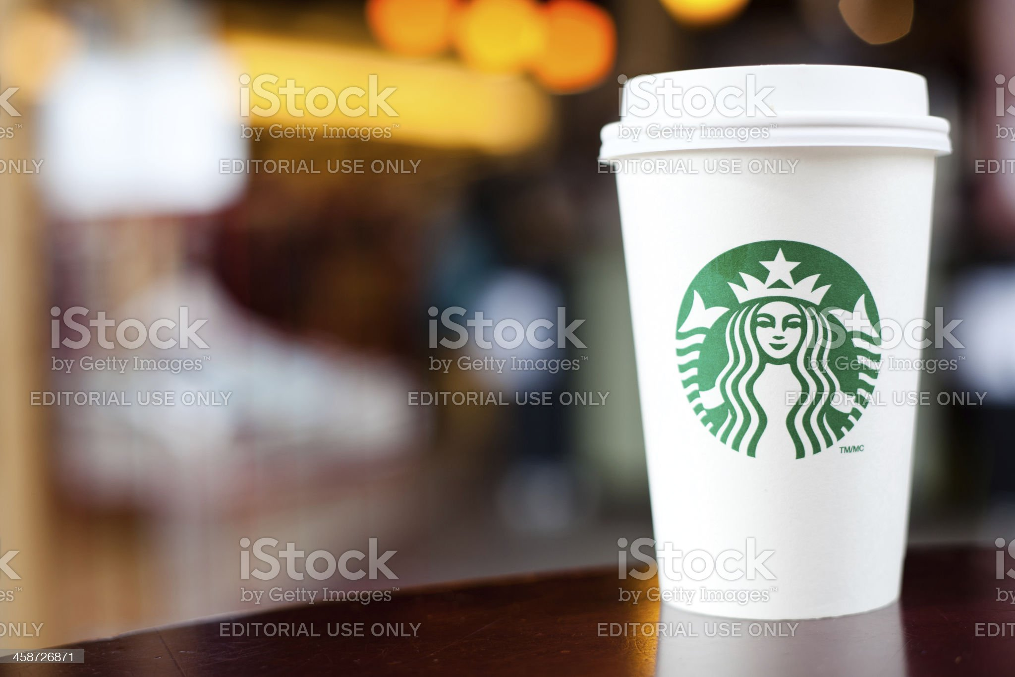 Grande Starbucks to go cup on table royalty-free stock photo