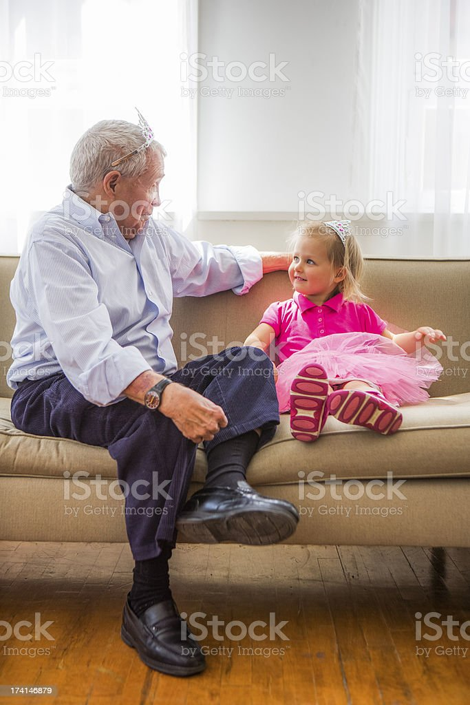 Grandfather and grandaughter playing Princess royalty-free stock photo