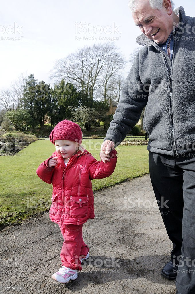 grandfather and grandaughter walking royalty-free stock photo
