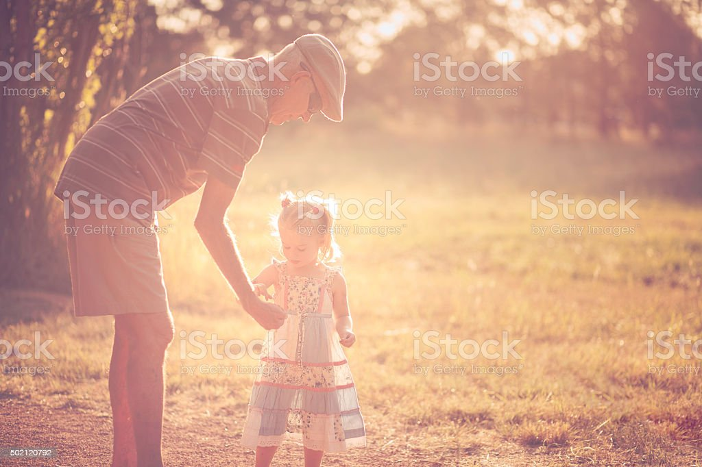 Grandfather and grandchild stock photo