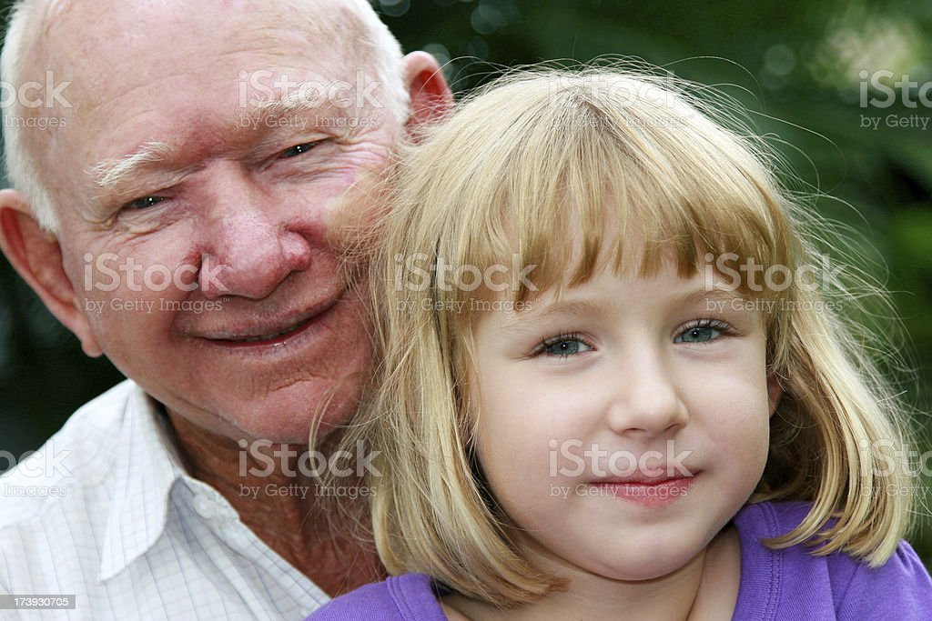 Grandfather and Granddaughter Caucasian Little Girl close up faces royalty-free stock photo