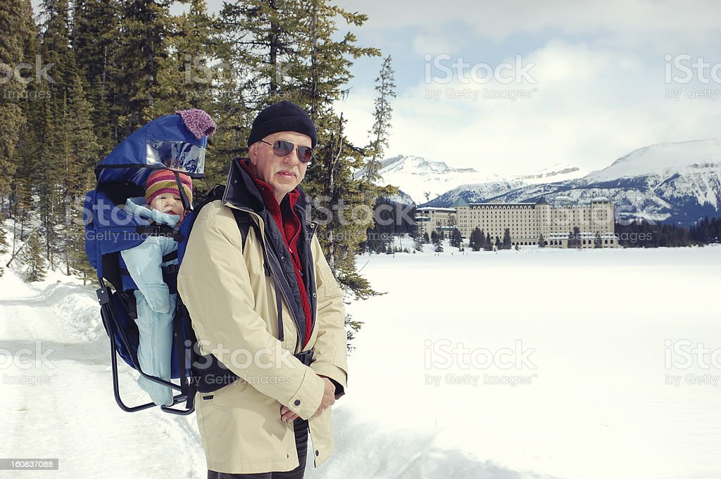 Grandfather and granddaughter hiking on a frozen Lake Louise, Canada stock photo