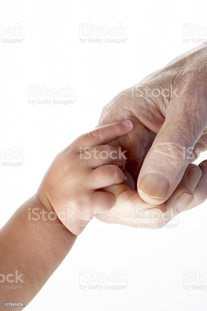 Grandfather and granddaughter holding hands royalty-free stock photo