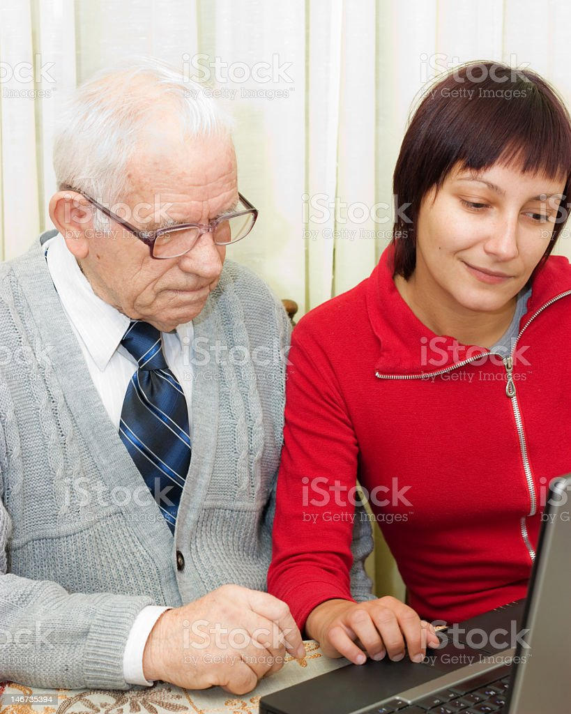 Grandfather and granddaughter royalty-free stock photo