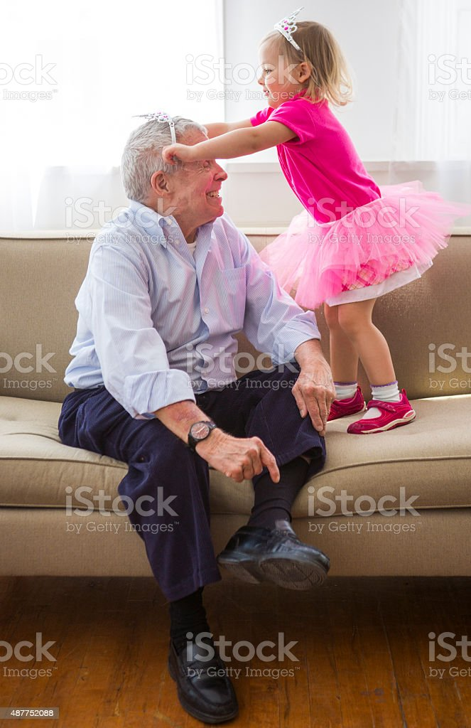 Grandfather and Granddaughter Play Dress up stock photo