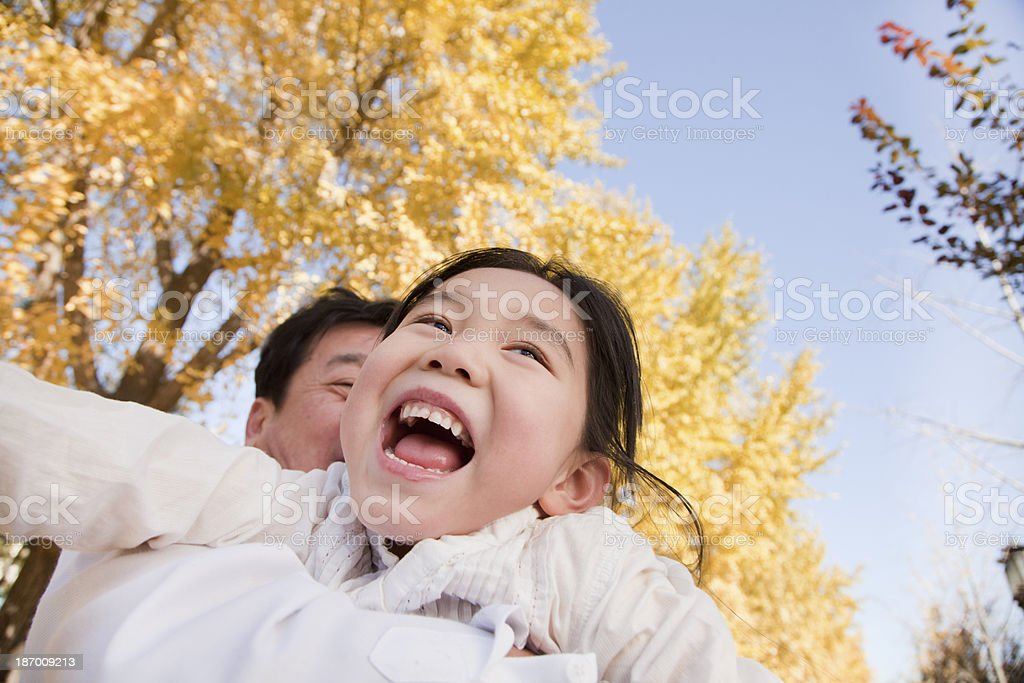 Grandfather and Granddaughter Playing in the Park royalty-free stock photo
