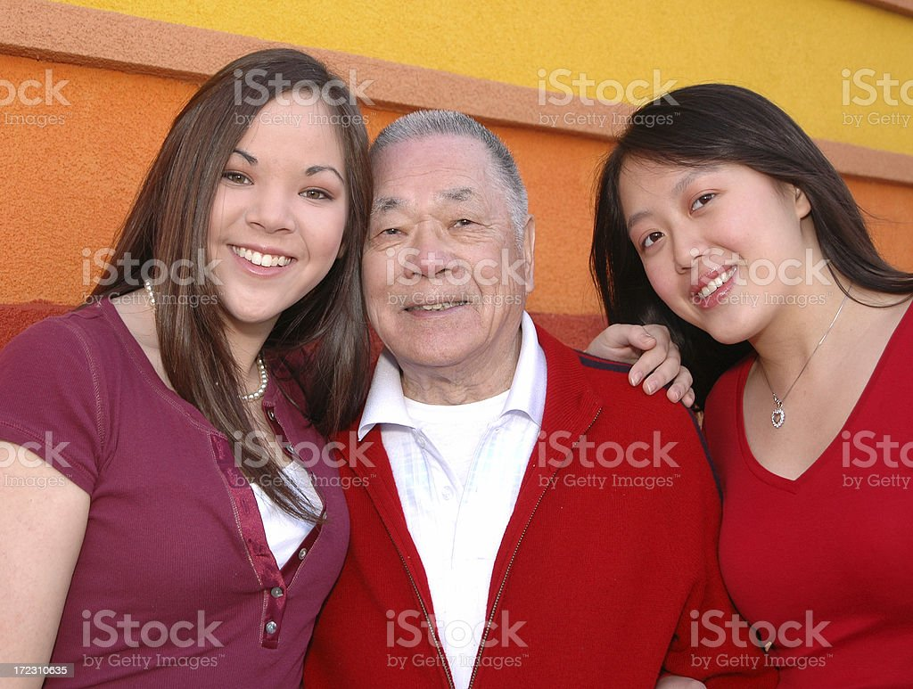 Grandfather and granddaughters stock photo