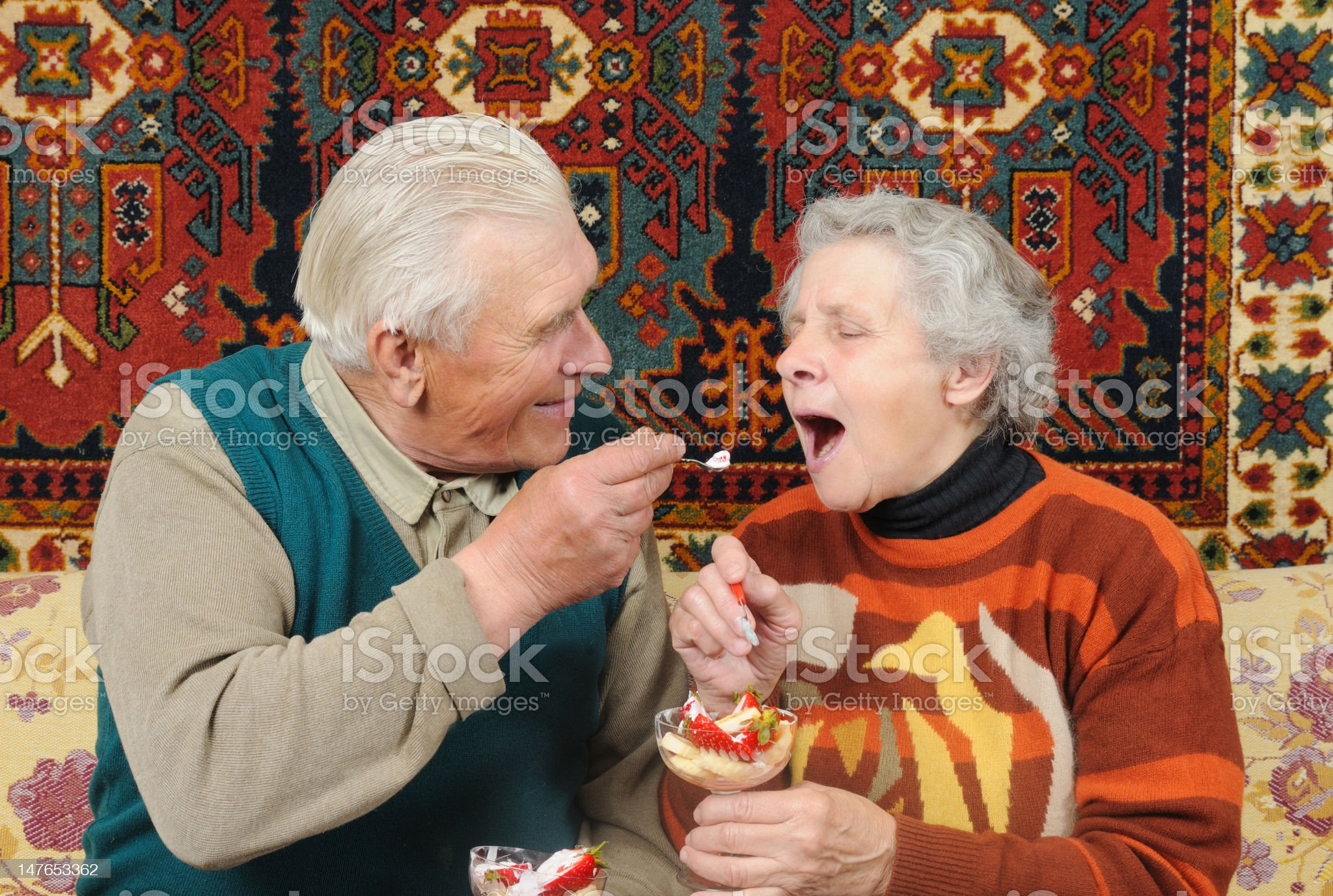 grandfather and grandmother eat strawberrys royalty-free stock photo