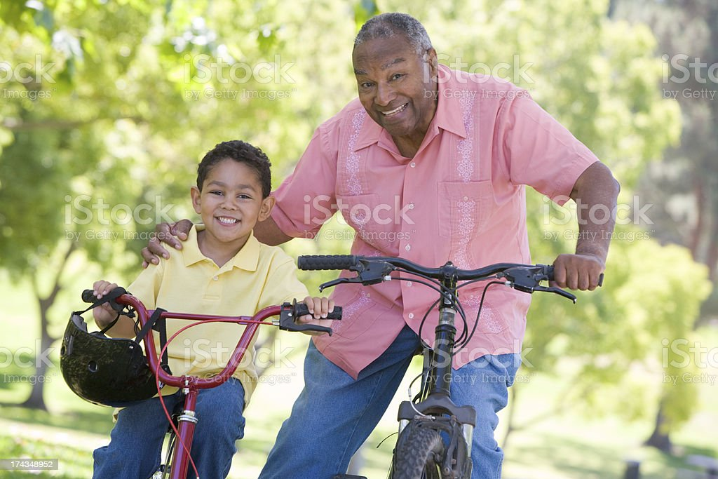 Grandfather and grandson enjoying bike ride royalty-free stock photo