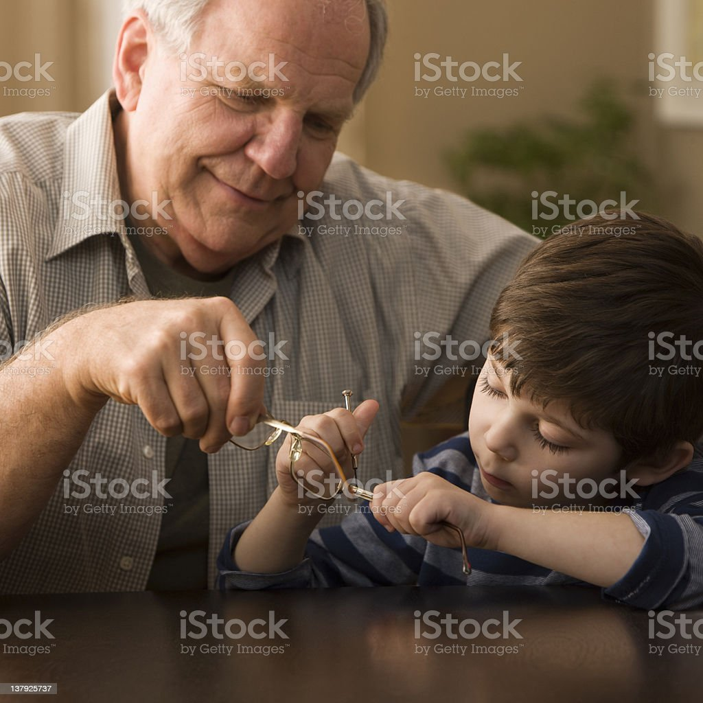 Grandfather and grandson fixing glasses royalty-free stock photo