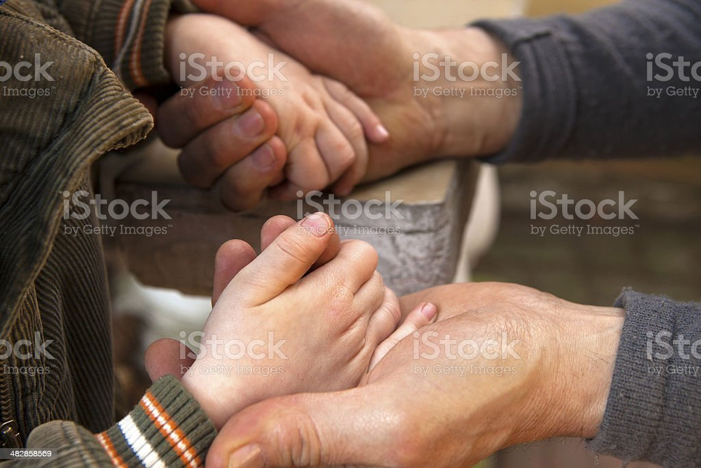 Grandfather and grandson holding hands royalty-free stock photo