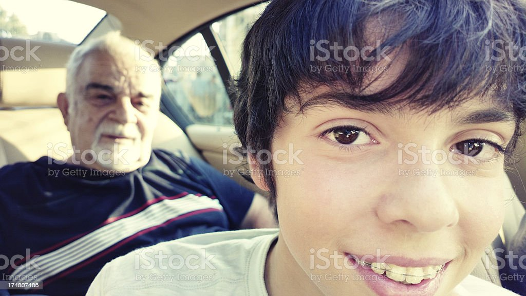 Grandfather and grandson in the car royalty-free stock photo