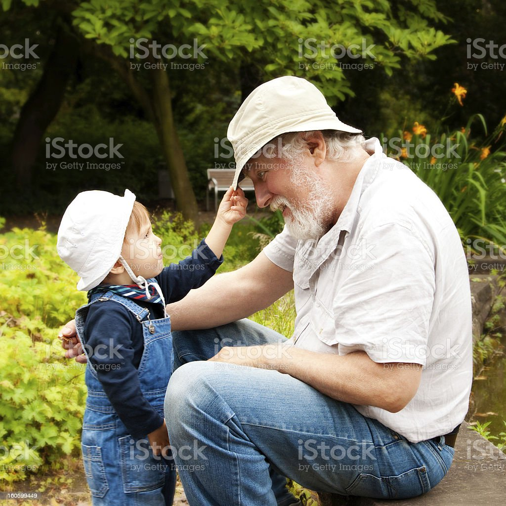 A grandfather and grandson in the garden royalty-free stock photo