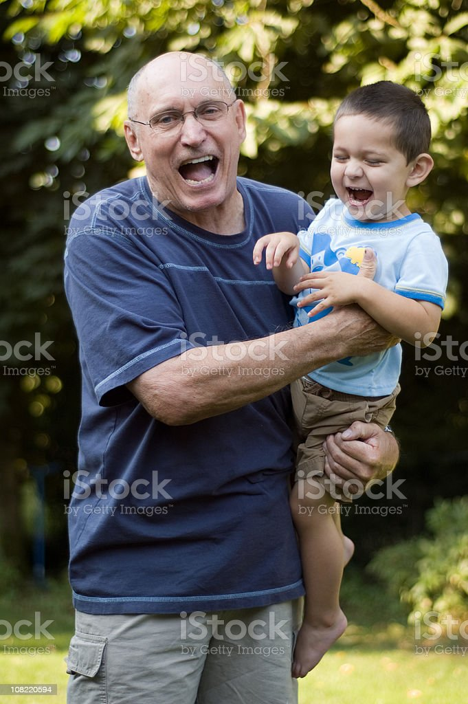 Grandfather and grandson laughing. royalty-free stock photo