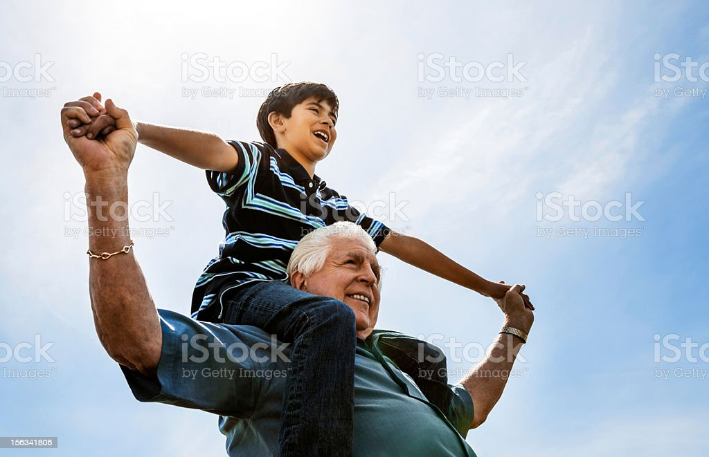 Grandfather and Grandson on Shoulders stock photo