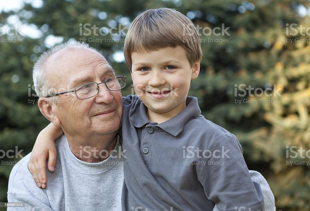 Grandfather and grandson outside royalty-free stock photo