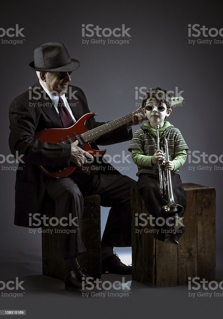 grandfather and grandson performing jazz stock photo