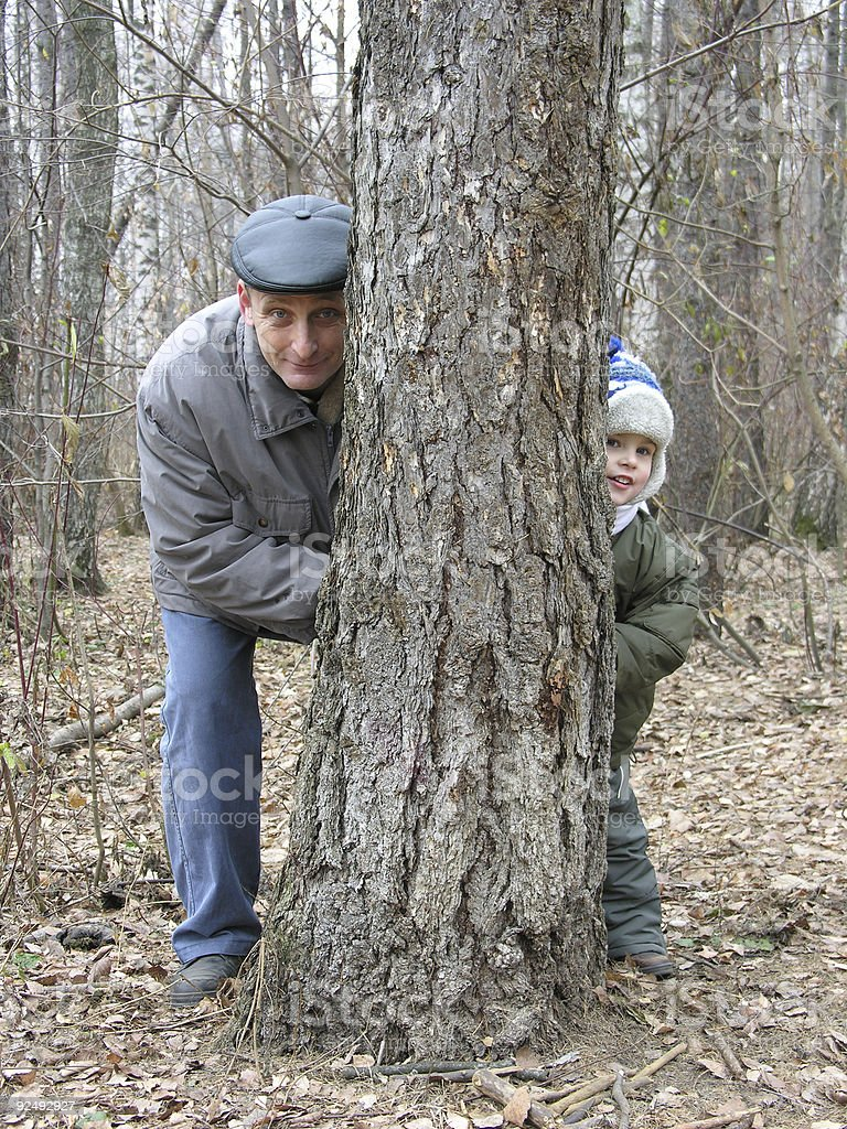 grandfather and grandson play hide-and-seek royalty-free stock photo