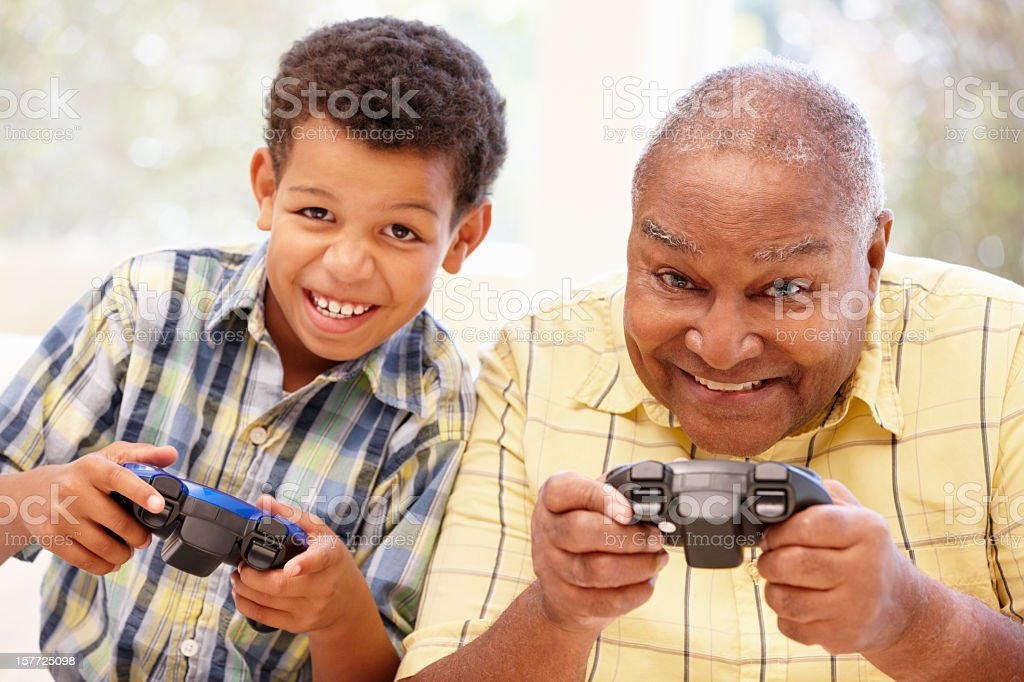 Grandfather and grandson playing computer games royalty-free stock photo