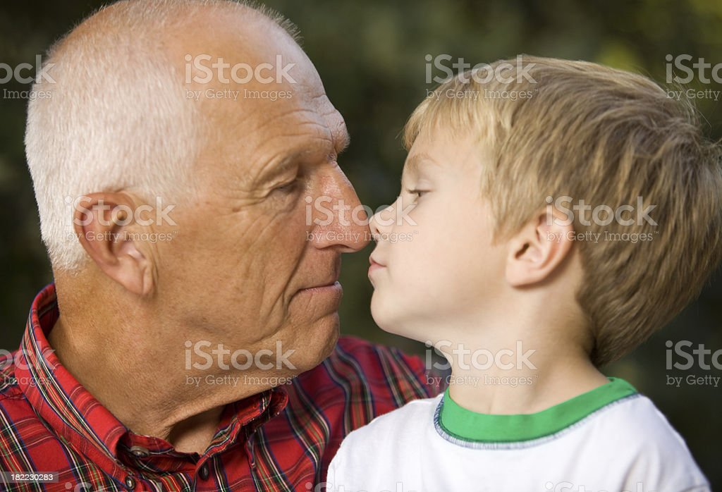 Grandfather and Grandson Share an Eskimo Kiss royalty-free stock photo