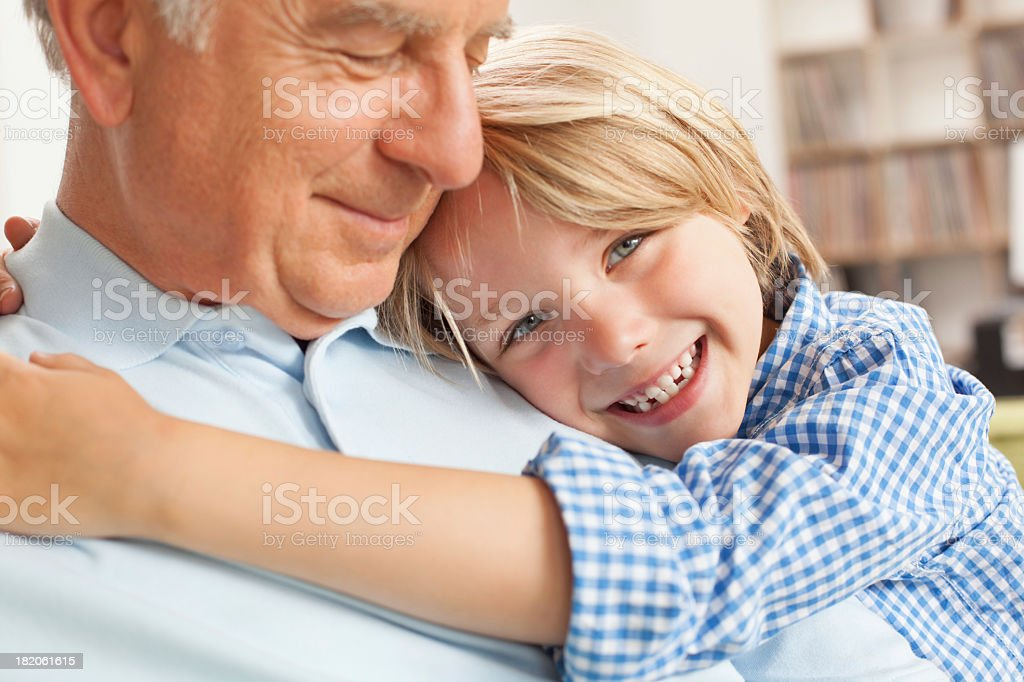 Grandfather and grandson together in living room royalty-free stock photo