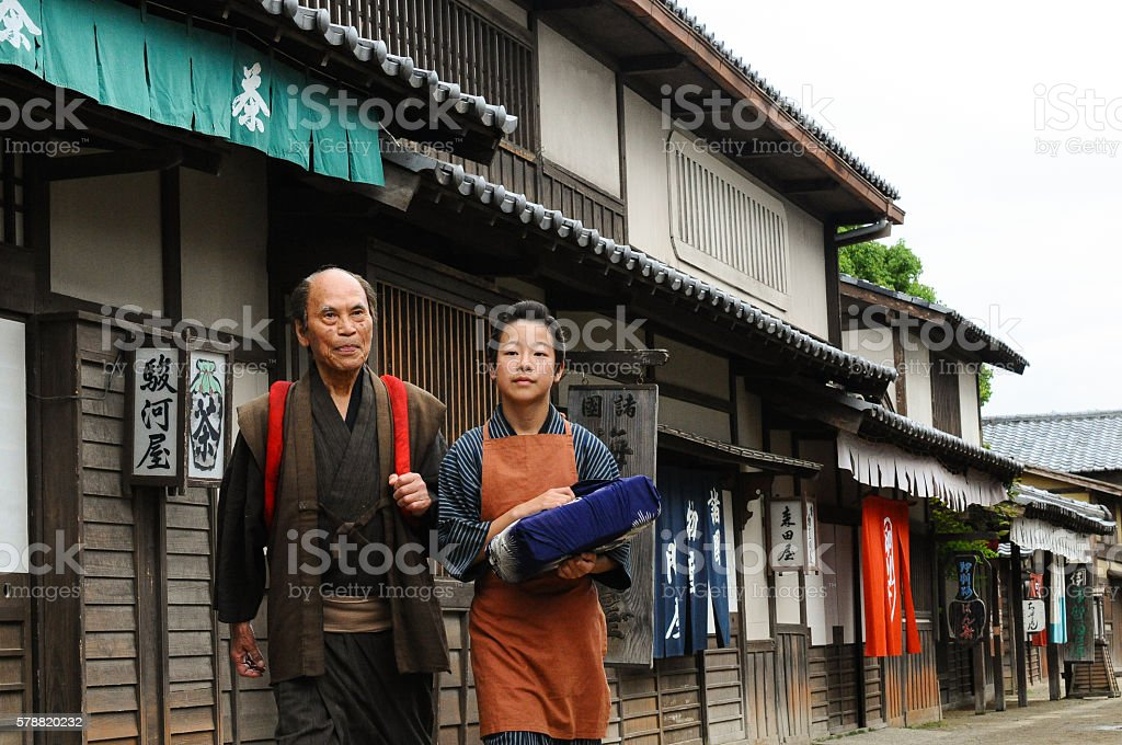 Grandfather and Grandson walking on Japanese village stock photo