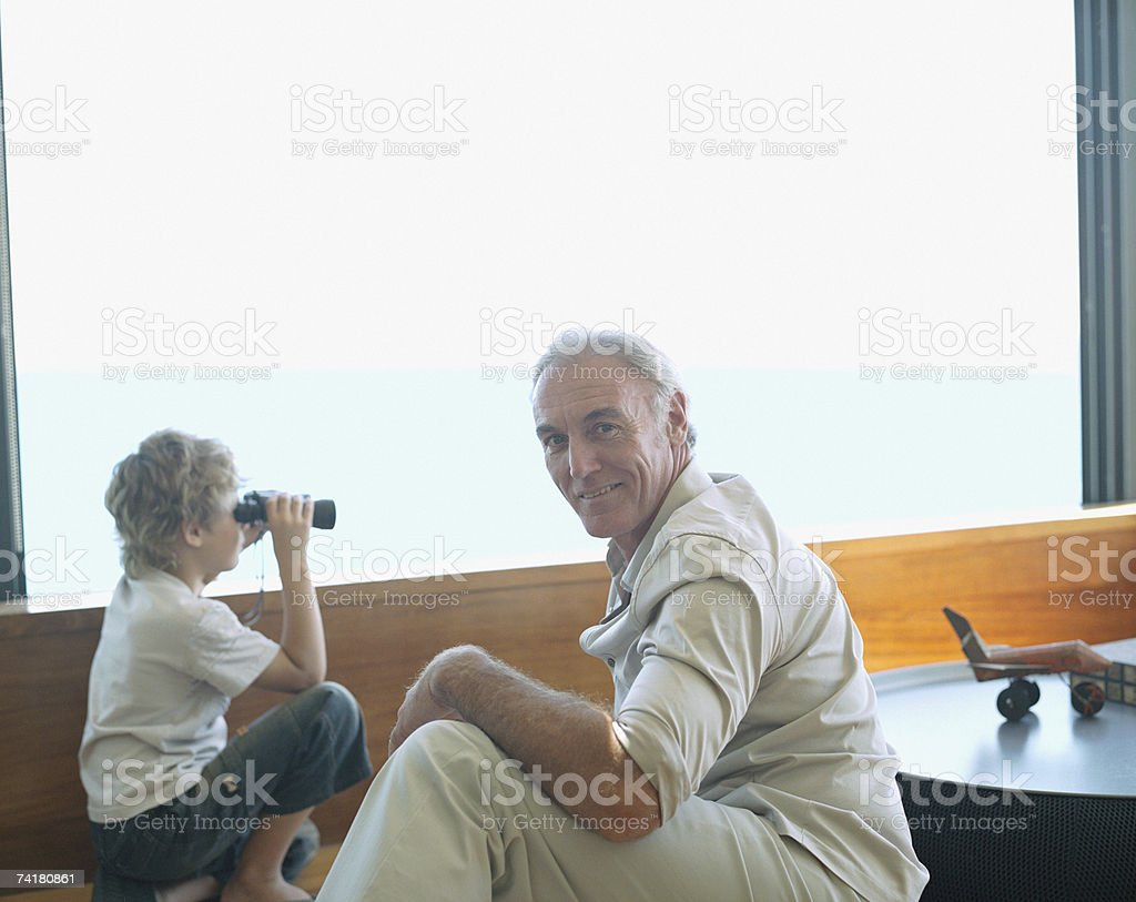 Grandfather and grandson with binoculars royalty-free stock photo