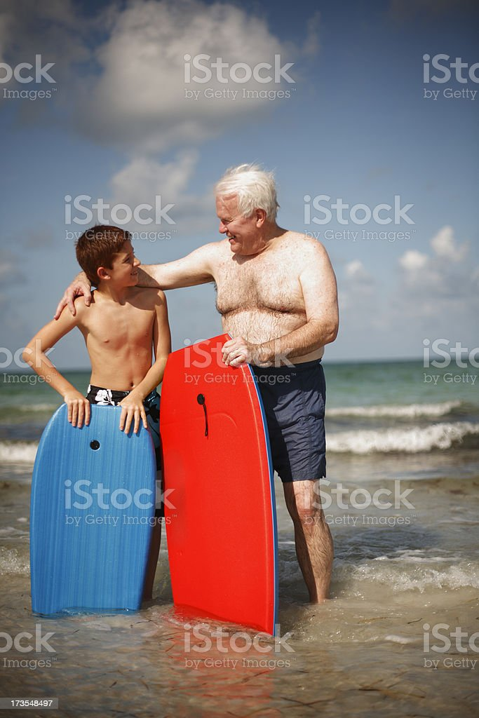 Grandfather and Grandson with Surfboards royalty-free stock photo