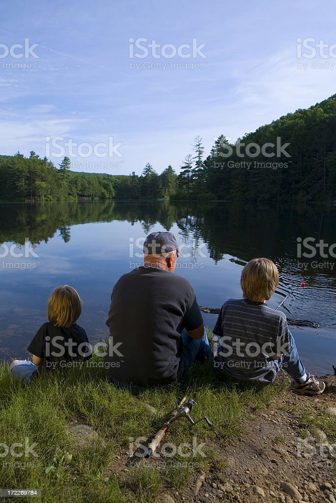 grandfather and grandsons fishing royalty-free stock photo