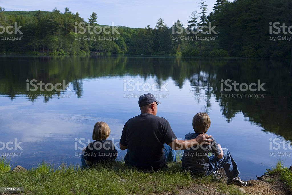Grandfather and grandsons fishing. royalty-free stock photo